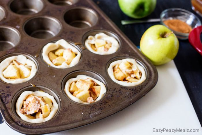 Muffin Tin Apple Pies: Little buttery, flaky pie bites, filled with apple and spices, and drizzled in caramel and salt!