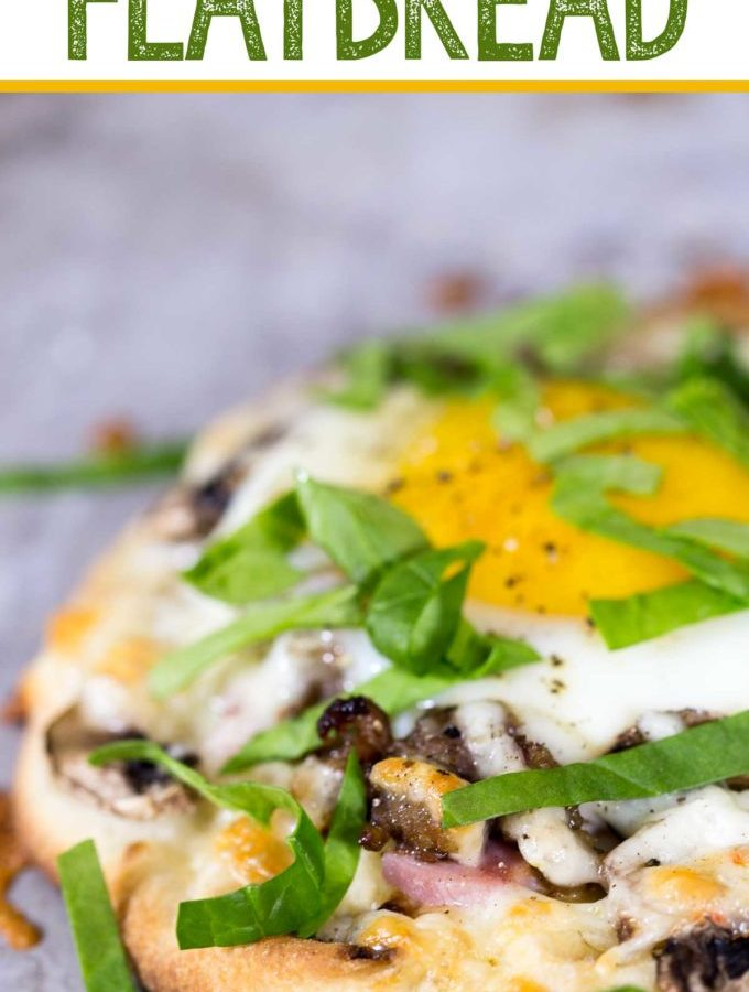 Breakfast flatbread: breakfast meats, cheese, veggies, and an egg with a perfectly runny yolk makes this an easy, hearty, and delicious breakfast.