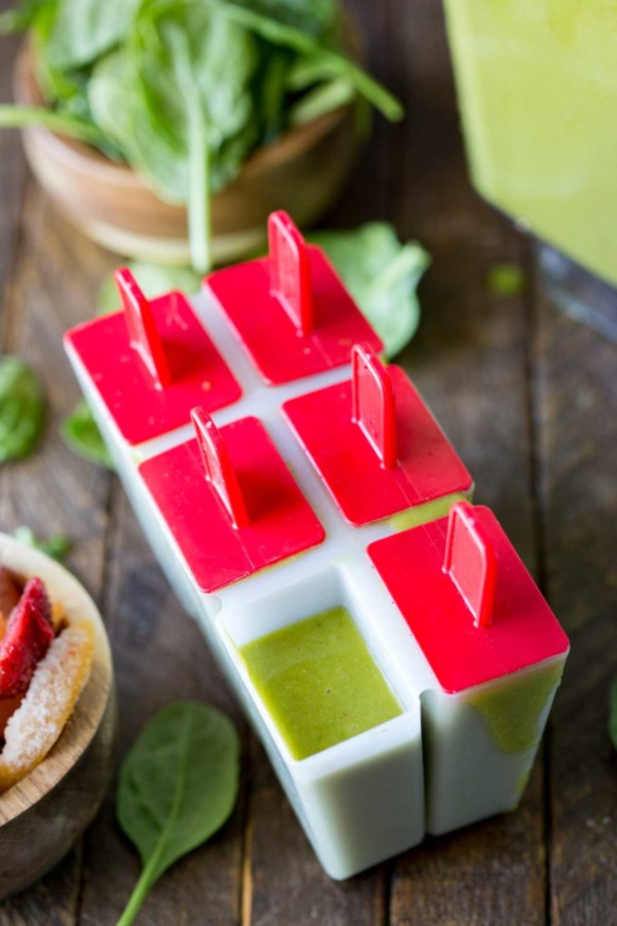 Green smoothie pops in mold