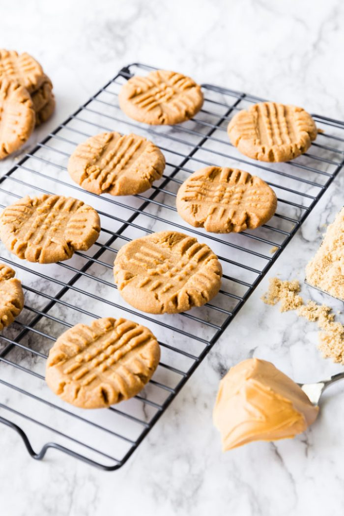 A cooling rack filled with the easiest 3 ingredient peanut butter cookies