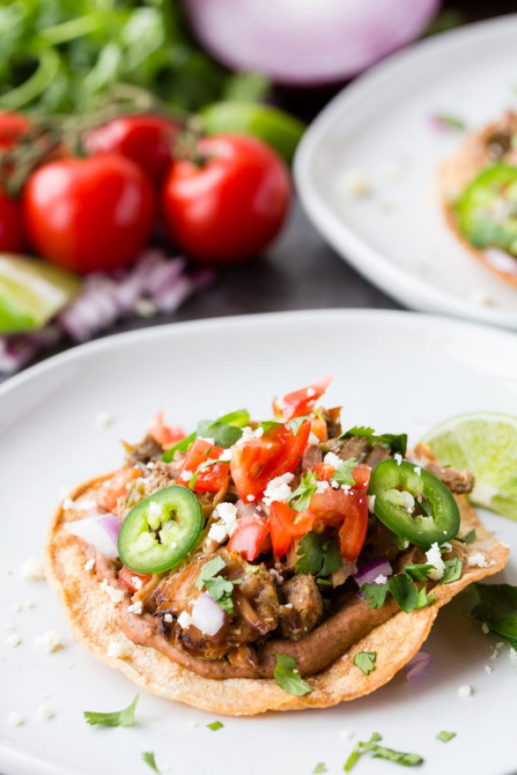 Crispy Carnitas Tostadas loaded with all the good stuff.