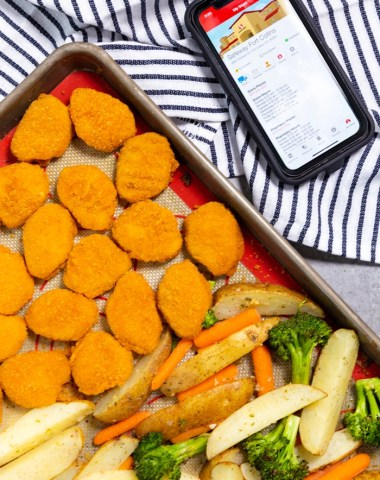 Chicken nuggets and ranch potatoes and veggies on a sheet pan