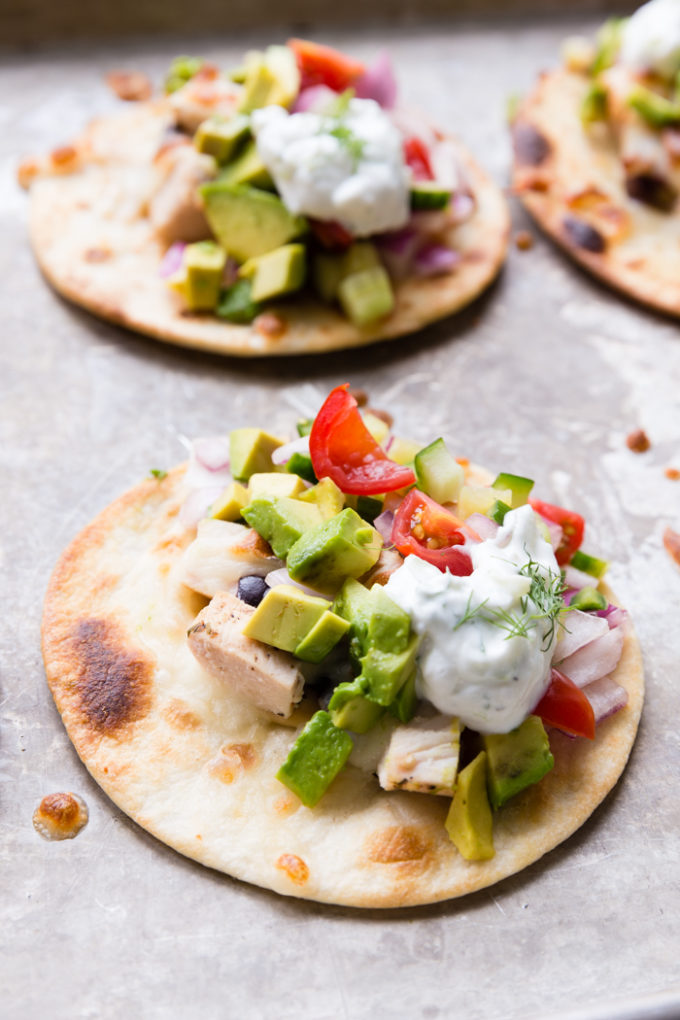 A chicken greek taco that has street taco vibes