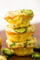 jalapeno popper egg muffins stacked in a stack of three with a few slices of jalapenos around