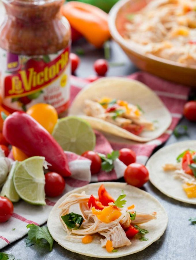 Mango Habanero chicken tacos cooked in the slow cooker. These are so easy!