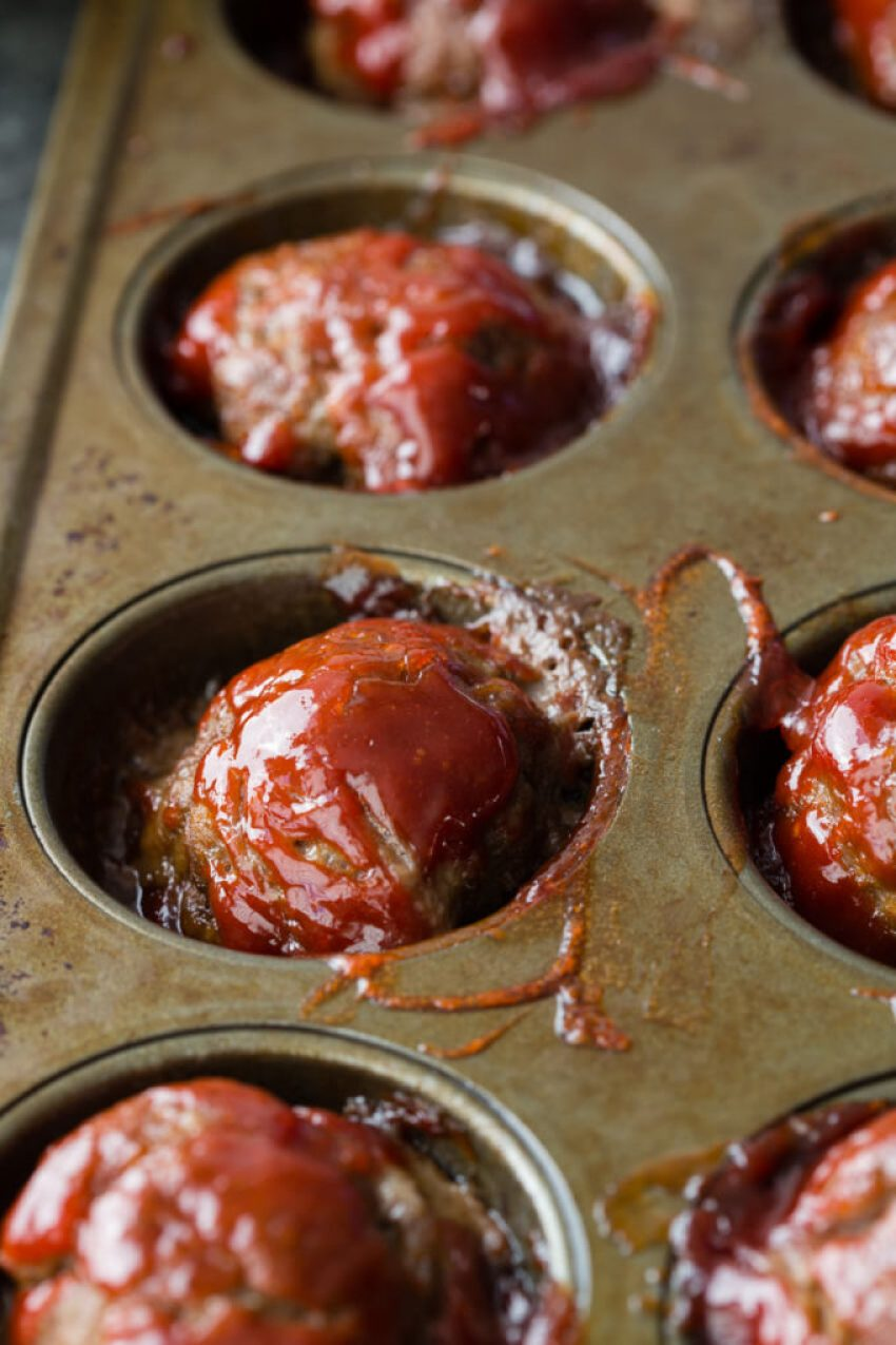 Individual Meatloaf Minis are packed with flavor, made in a muffin tin for thorough cooking and easy serving, and rivals any meatloaf out there!