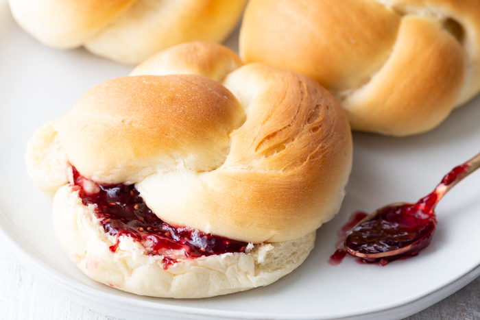 Delicious and beautiful dinner rolls with butter and jam