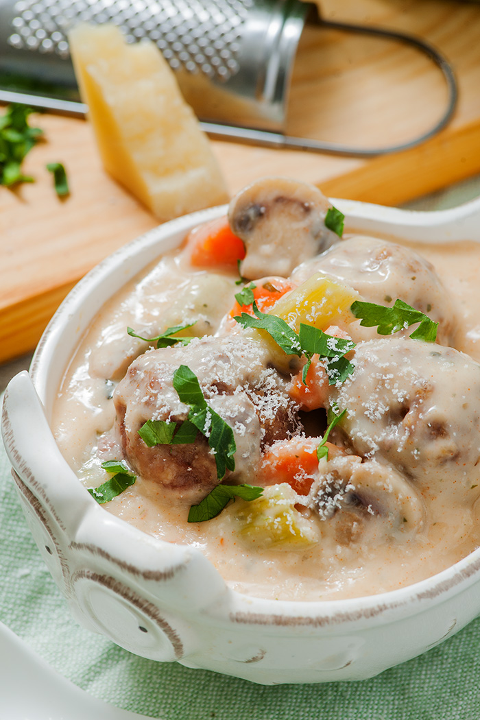 one pot creamy meatball soup, in a white bowl