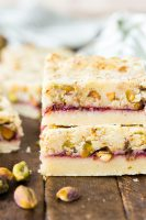 Two raspberry pistachio shortbread bars