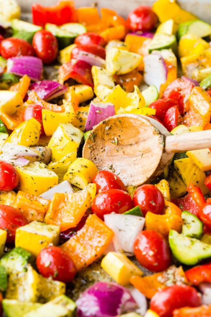 A pan full of vegetables getting ready to be roasted