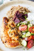 Skillet greek Chicken birds eye close up barely showing plate