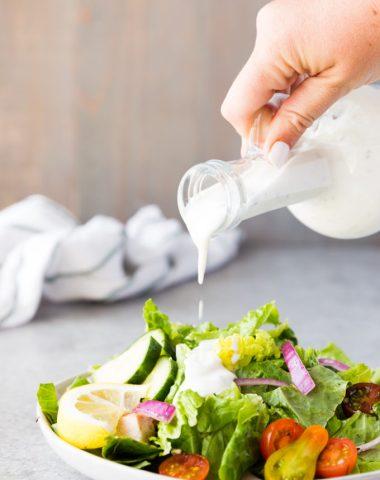 Tzatziki ranch dressing on a greek salad