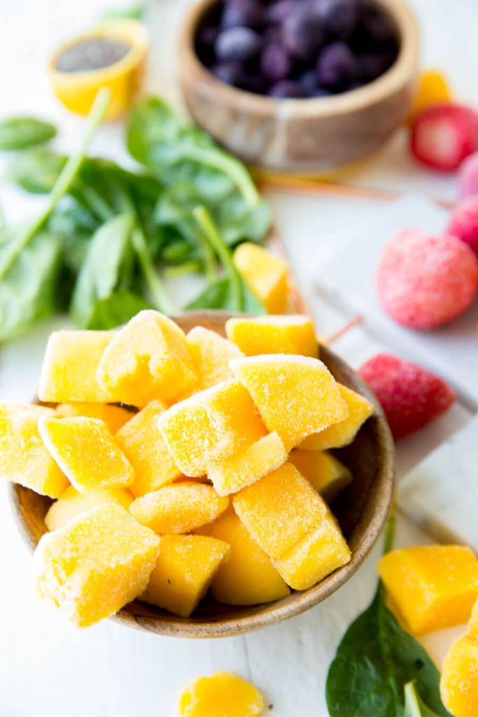Adding frozen fruit to a freezer smoothie pack