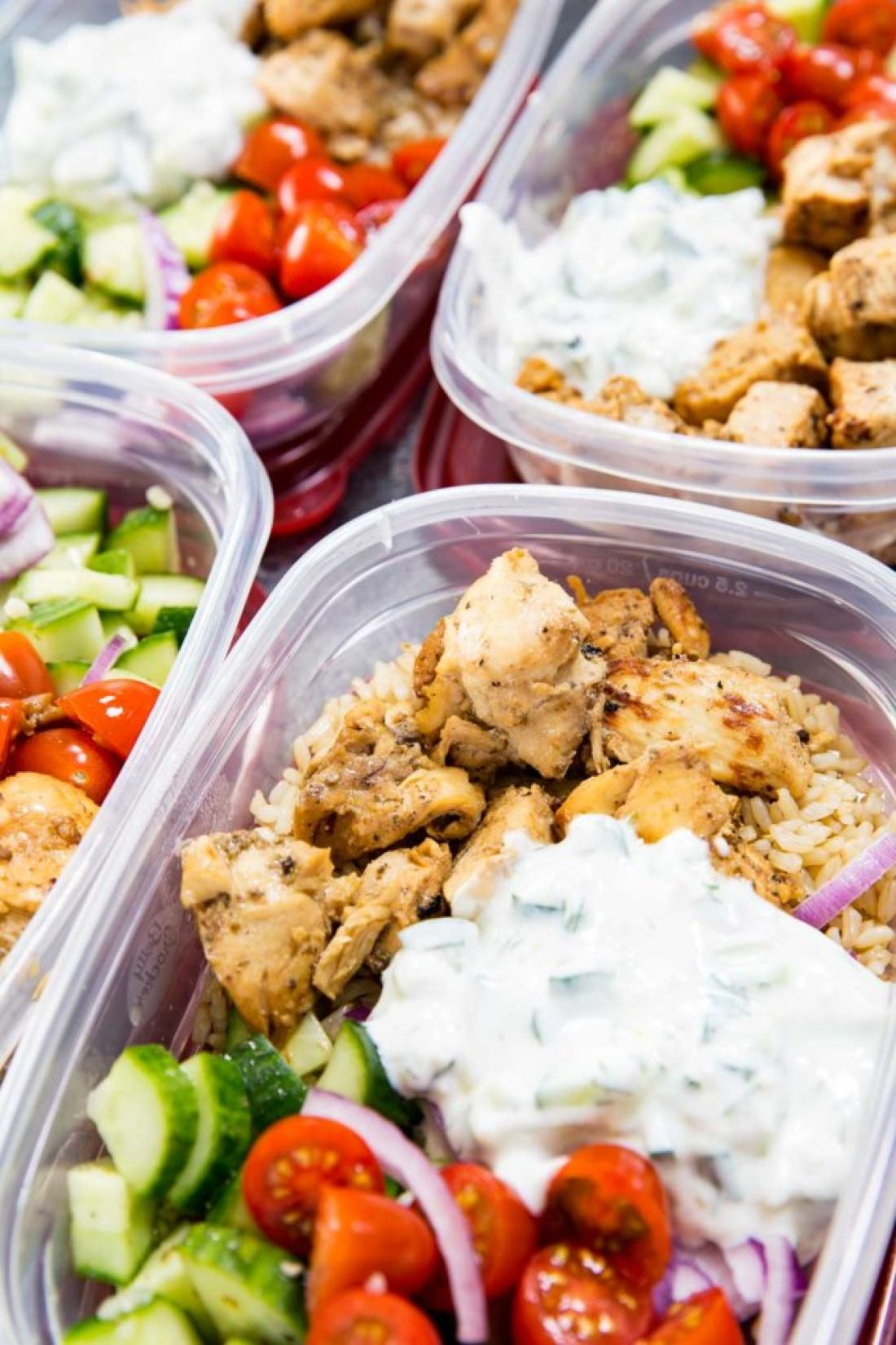 Healthy Greek Chicken Recipes: Insanely delicious Greek Chicken bowl recipes. Greek Marinated Chicken, cucumber salad, tzatziki, red onion, and tomato, served over brown rice. These are quick and easy to make, and will help you be set for the week.