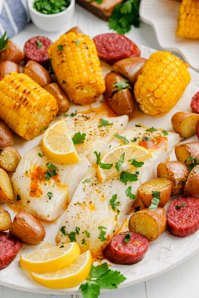 Roasted Halibut with vegetables and andouille sausage.