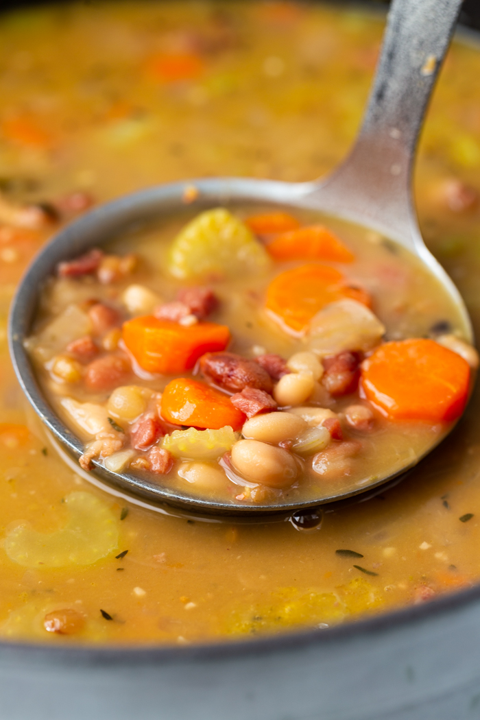 close up of instant pot ham and bean soup in a latle