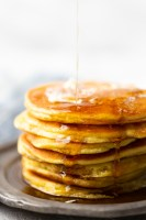 Low carb pancakes made with coconut flour--keto friendly, a stack with butter and syrup