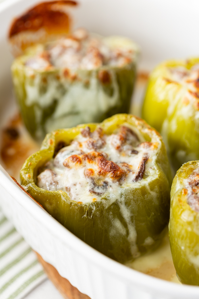 a casserole dish with philly cheese steak stuffed peppers