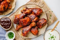 Slow Cooker BBQ Drumsticks on a plate with sauces to the side