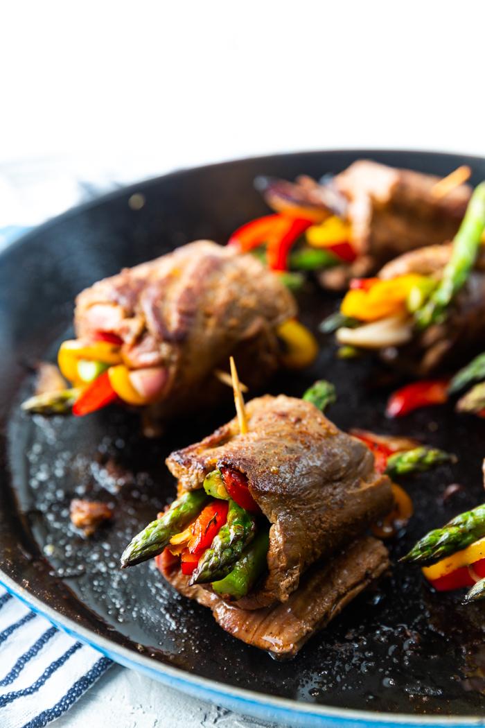Steak roll up in a hot cast iron pan. Steak fajitas