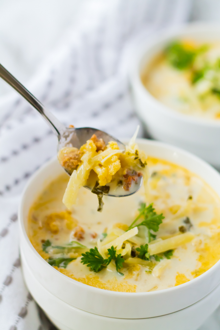 zuppa toscana soup with a spoon
