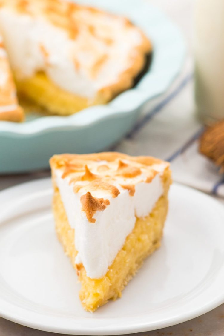 Easy and delicious coconut cream pie, with fluffy meringue on top of a white plate