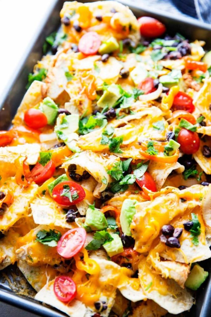 Chicken Nachoes are ultra filling, easy to make, and are loaded with crunchy chips, melty cheese, flavorful chicken, and your favorite toppings!