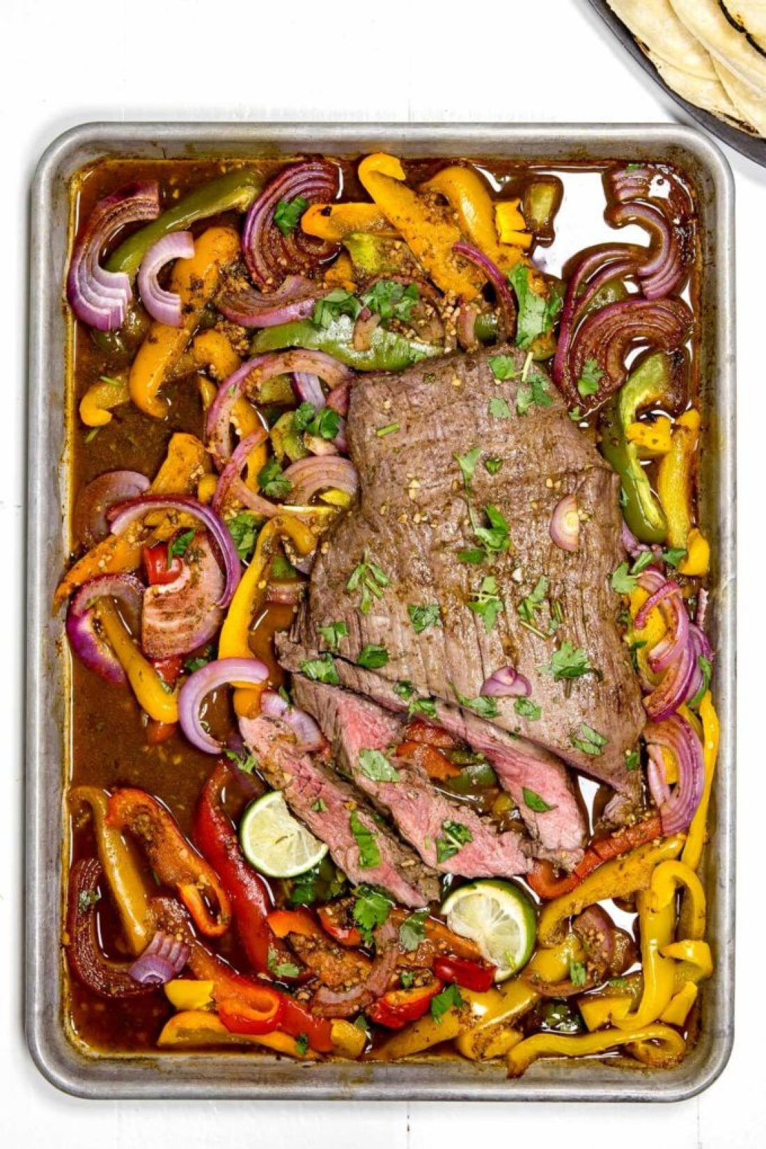 Sheet pan flank steak fajitas are packed with flavor and the perfect meal. My husband said this was his favorite thing I have ever made.