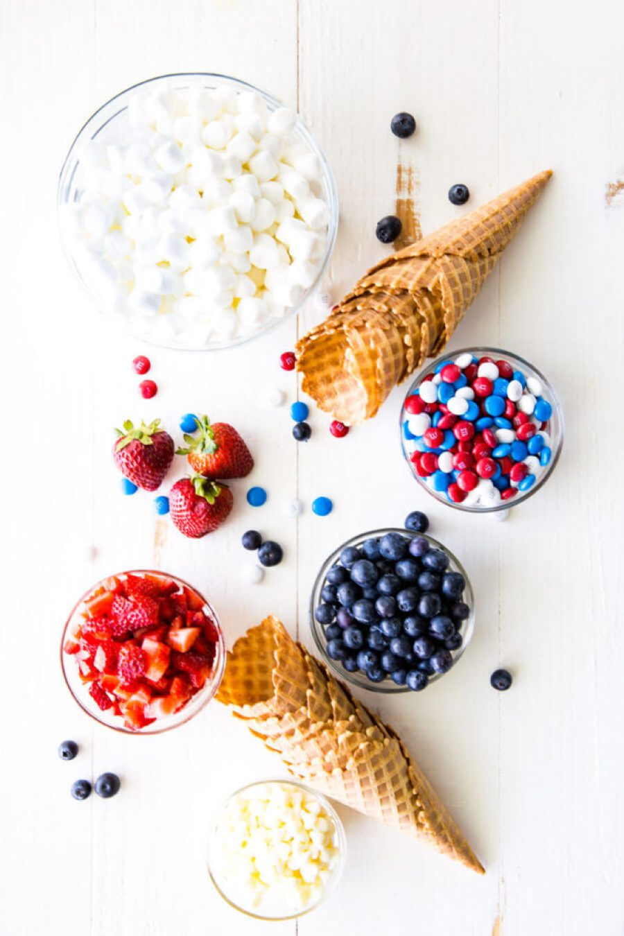 Campfire cones, waffle cones filled with marshmallows, fruit, and chocolate, and cooked in a campfire or oven.