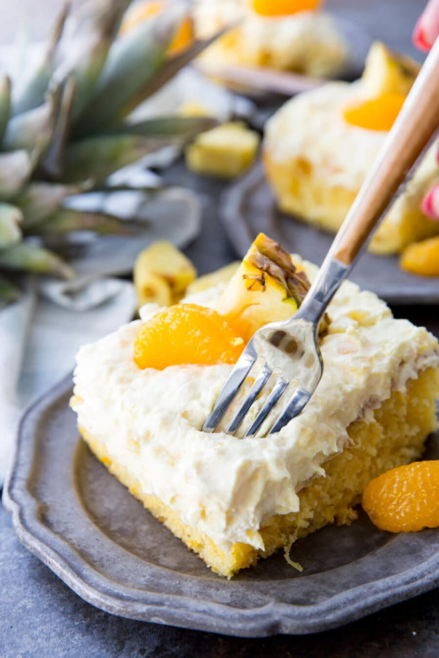 Mandarin Orange Cake with Pineapple fluff frosting or pig pickin' cake is delicious yellow cake with fruity highlights. It is a family favorite
