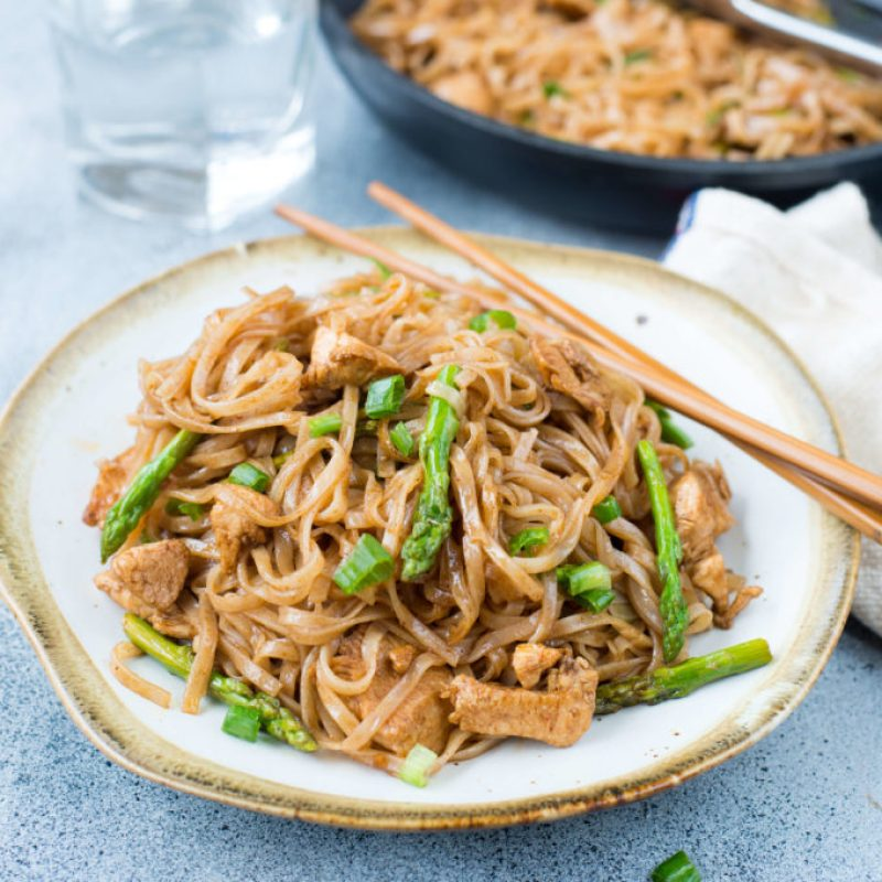 Chicken Stir Fry Rice Noodles is a quick stir fry recipe with bursting Asian flavors. All you will need is one pan and less than 30 minutes to make a delicious weeknight dinner. While Chicken and asparagus works as a wonderful combination, you add any vegetable of your choice.