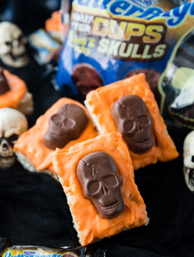 Tasty and festive Halloween Rice Krispie Treats with Butterfinger Peanut Butter Skulls