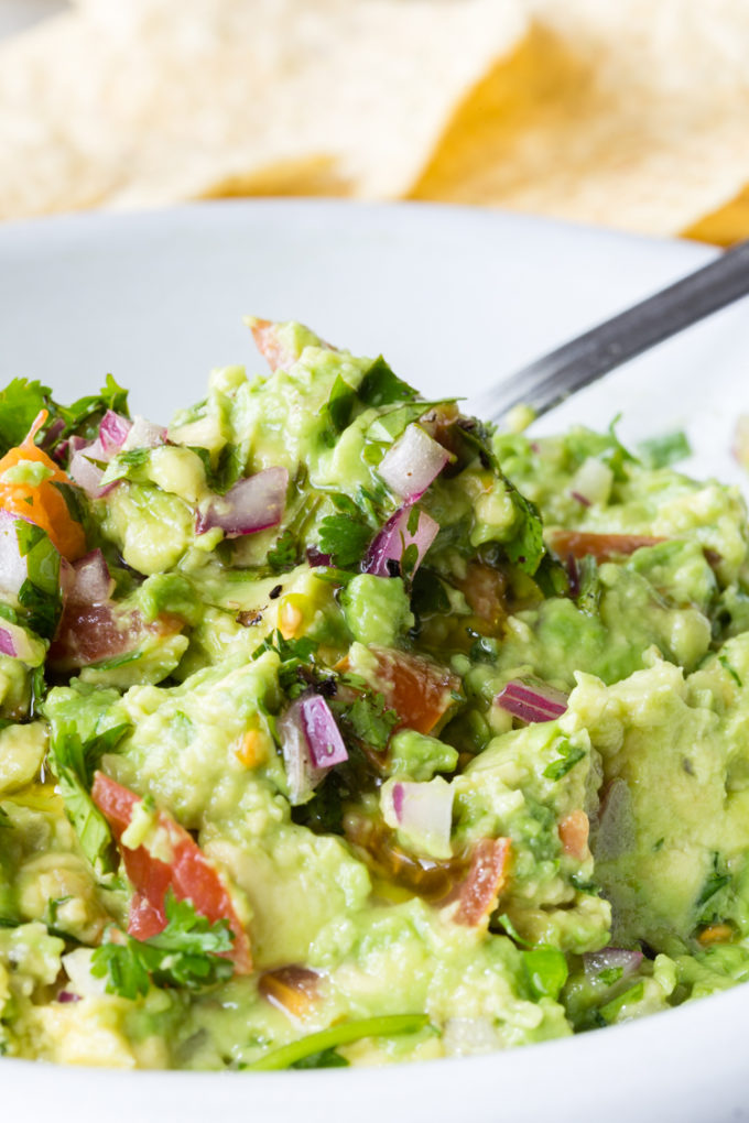 How to make delicious guacamole with fresh avocados and other fixings like cilantro, red onion, lime juice, etc.