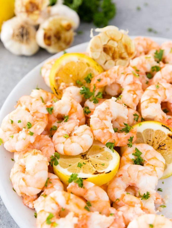 Garlic butter shrimp with fresh parsley and lemon