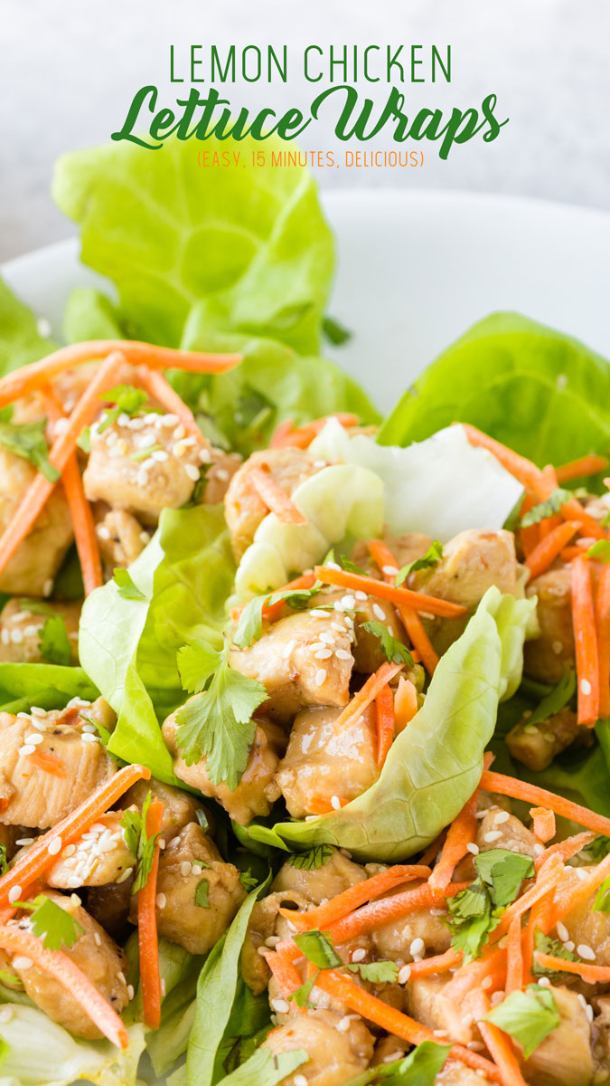 A plate full of lemon chicken lettuce wraps: tender chicken topped with matchstick carrots, toasted sesame seeds, and cilantro. Great summer brunch food.