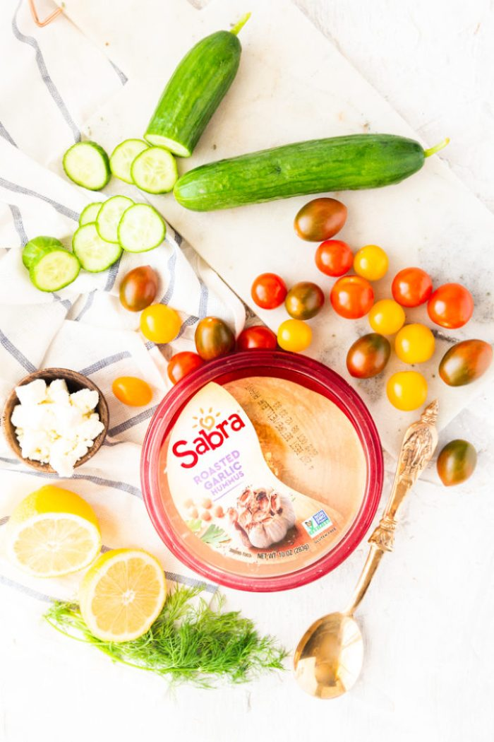 Delicious greek chicken power bowls make a great back to school lunch, all the ingredients needed, including Sabra Hummus