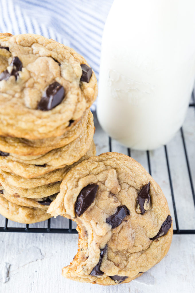 Traeger smoked chocolate chip cookies, with some milk and a cooling rack