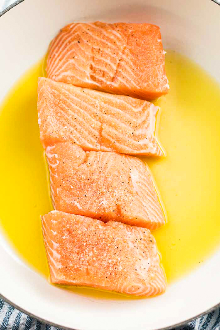 Step two for this salmon recipe is adding in your seasoned salmon fillets