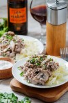 low carb beef stroganoff with pepper grinder in back ground