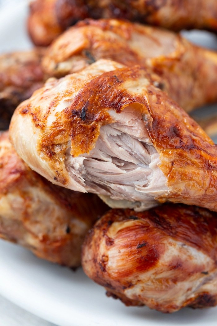 Turkey  legs from the air fryer on a plate with a bite taken out of one of them
