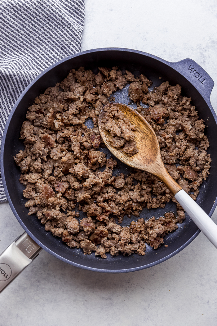 A skillet of browned sausage crumbles
