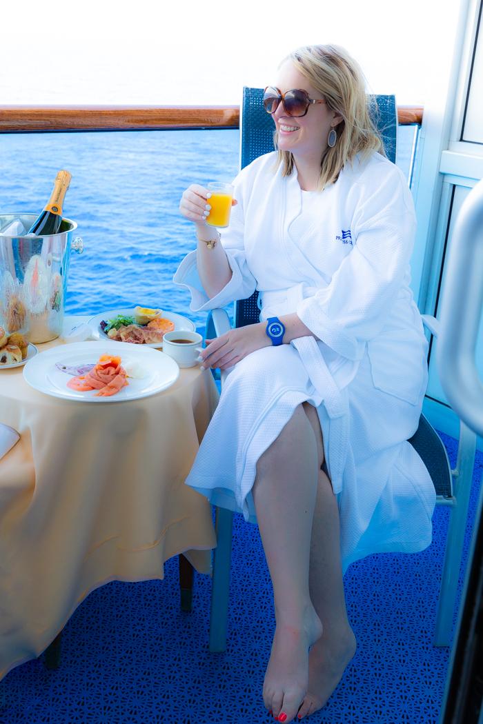 Having breakfast on the balcony of the ship
