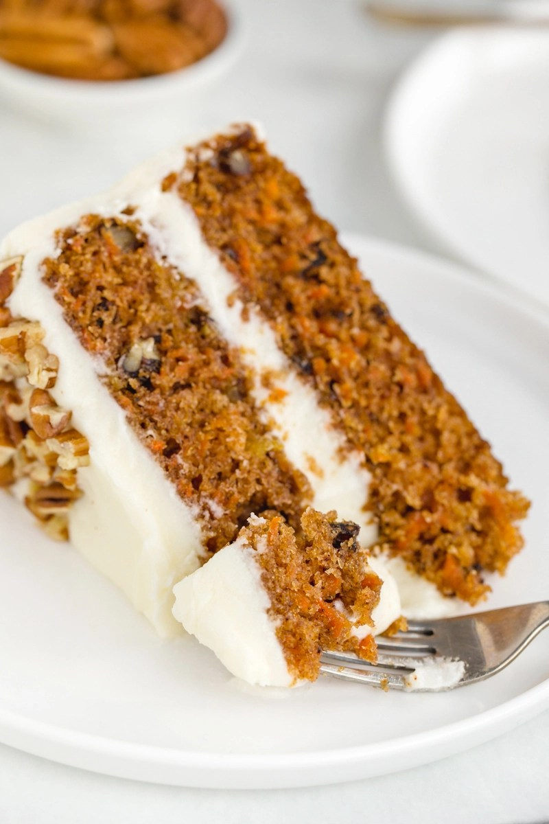 A big slice of carrot cake, with a fork