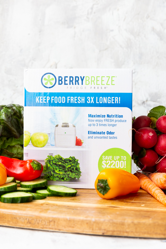 Berry Breeze Fridge Fresh in the box on a cutting board with fresh produce