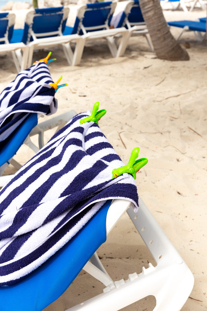 Towel clips for keeping towels on chairs