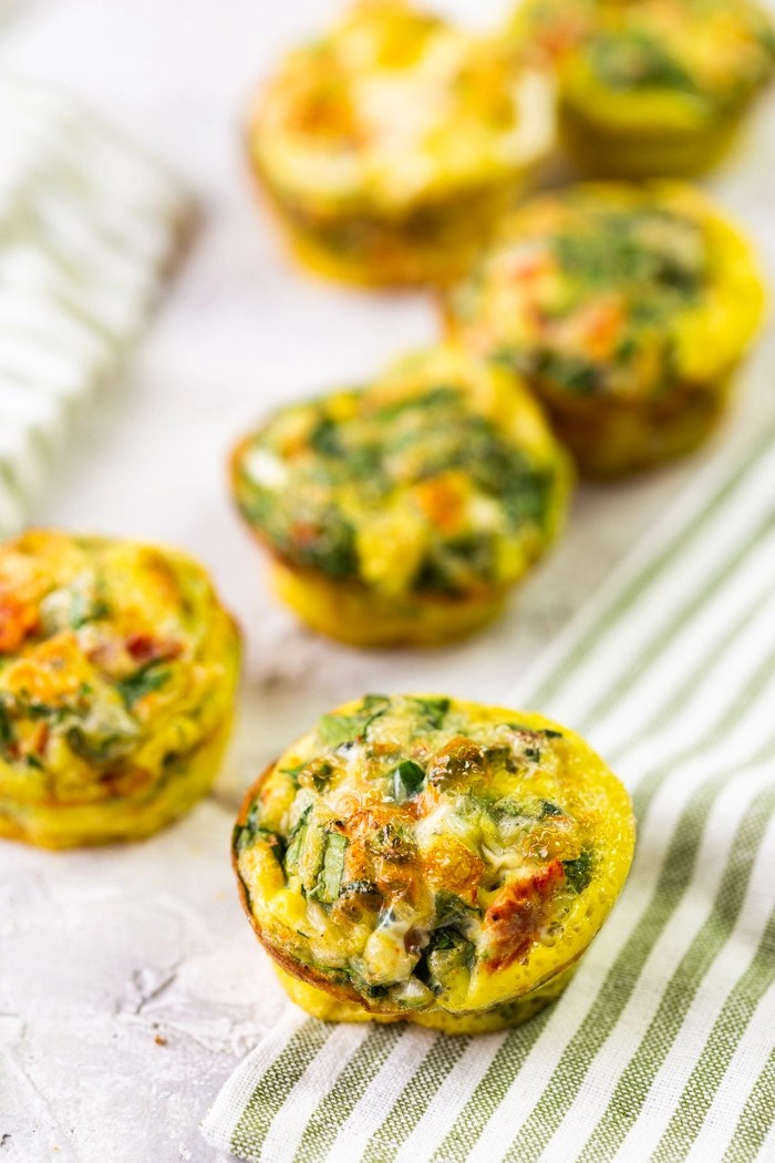 Egg muffins on a surface with a linen
