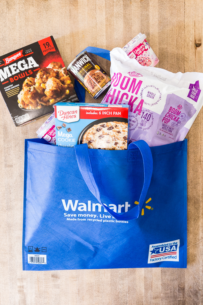 A walmart bag with food coming out the top of it