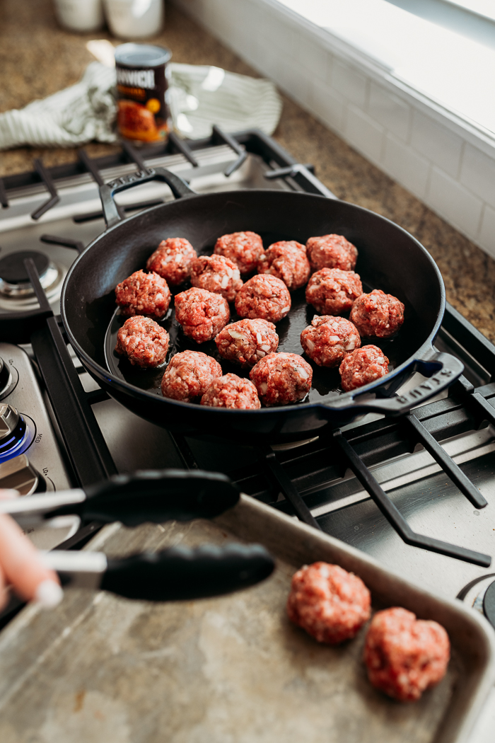 A skillet browning meatballs for manwich sloppy joe meatball subs
