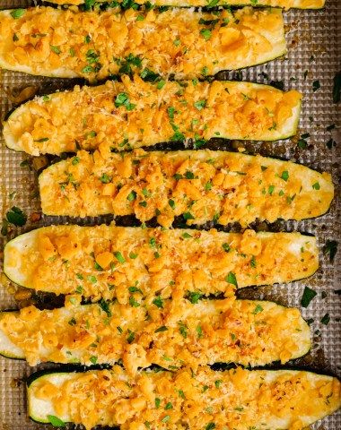 Baked zucchini in a baking dish, covered in a cracker and cheese mixture