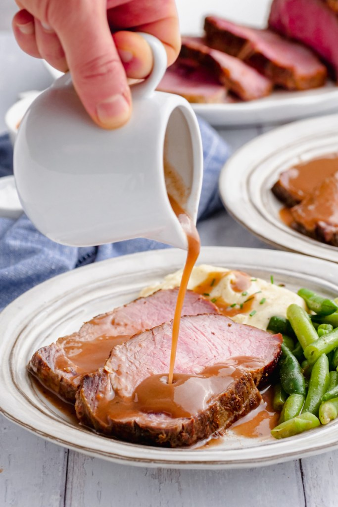 gravy pouring onto meat